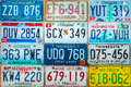 Vintage car license plates on a wall Royalty Free Stock Photo