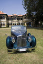 Vintage car and mansion Royalty Free Stock Photo