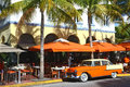 Vintage car in ocean drive miami beach florida usa march a is parked front of palms art deco buildings the sidewalke is full of Stock Image