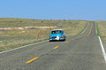 Vintage car on route seligman arizona usa in covered miles between needles california and the new mexico border as Royalty Free Stock Photo