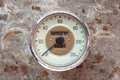 Vintage car speedometer on a rusty background Royalty Free Stock Photos