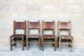 Vintage chairs at the stone wall four Royalty Free Stock Image