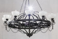 Vintage chandelier with candles in room black white walls Royalty Free Stock Images