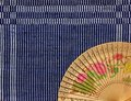 Vintage Chinese wood fan on cloth