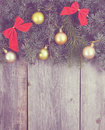 Vintage christmas background fir tree with decoration on a wooden board Stock Photos