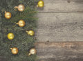 Vintage christmas background fir tree with golden decoration on a wooden board Royalty Free Stock Photos