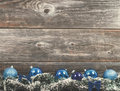 Vintage christmas background tree with baubles on wood texture Royalty Free Stock Photo