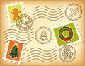 Vintage Christmas postage set on old paper. Stock Images
