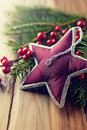 Vintage christmas star on natural spruce twigs close up Stock Photos
