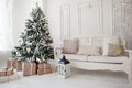 Vintage christmas tree with presents underneath in living room Royalty Free Stock Photo