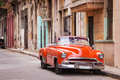 Vintage classic american car in a street in Old Havana Royalty Free Stock Photo