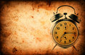Vintage clock on grunge old paper texture with space for text or image Stock Photography