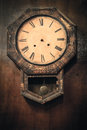 Vintage clock hanging on the wall Royalty Free Stock Image