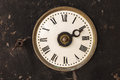 Vintage clock in a rusty old steel casing Royalty Free Stock Photography
