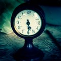 Vintage clock on a table Stock Image