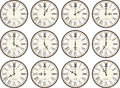 Vintage clocks different times isolated on white background each showing a time Royalty Free Stock Photo