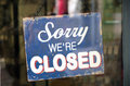 Vintage closed sign hanging in shop window Royalty Free Stock Image