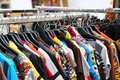 Vintage clothes of many colors for sale at flea market Royalty Free Stock Photo