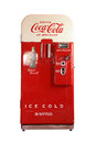 Vintage coca cola vending machine a classic with front bottle access door isolated on a white background Royalty Free Stock Photography
