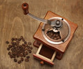 Vintage coffee grinder and beans Royalty Free Stock Image