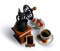 Vintage coffee grinder and cup of coffee cap coffe porcelain tableware Royalty Free Stock Photography