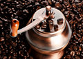 Vintage coffee mill in beans Stock Photos