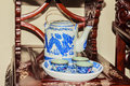 Vintage collection of blue dragon pattern on porcelain tea set w Royalty Free Stock Photo