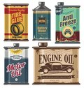 Vintage collection of car and transportation related products old motor engine oil cans anti freeze water tire glue bottles retro Royalty Free Stock Photos