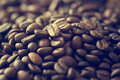 Vintage color tone, coffee beans on the old wooden background Royalty Free Stock Photo