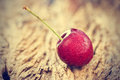 Vintage color tone style, cherry with water drops on the wooden background Royalty Free Stock Photo