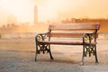 Vintage color tone style of wooden bench antique with sunrise on the vibrant background