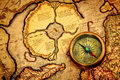 Vintage compass lies ancient map north pole also hyperborea arctic continent gerardus mercator map Royalty Free Stock Photos