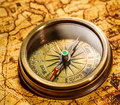 Vintage compass lies on an ancient world map still life Royalty Free Stock Photography
