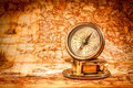 Vintage compass lies on an ancient world map. Royalty Free Stock Photo
