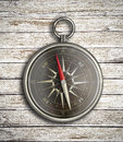 Vintage compass over wood background old Stock Photo