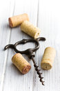 Vintage corkscrew and wine corks Stock Photo