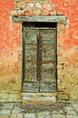 Vintage country door retro wooden and red wall Stock Photography