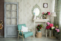 Vintage country house interior with mirror and a table with a va