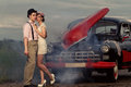 Vintage couple young next retro car in smoke Royalty Free Stock Images