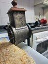 Vintage crank bread grater close up view of a Stock Photos
