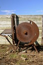 Vintage crosscut rusty wood saw a huge old belt driven for cutting logs and firewood has a safety shield out of position Royalty Free Stock Photos