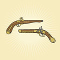 Vintage crossed flintlock pistols with ornament Royalty Free Stock Image
