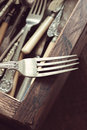 Vintage cutlery fork and a drawer box of in the background with a filter applied to image Royalty Free Stock Photos