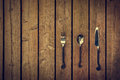 Vintage Cutlery - Fork, Spoon and Knife on Wood Background Royalty Free Stock Photo