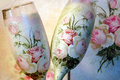Vintage decoupage decorated wineglasses for bride and groom Stock Photos