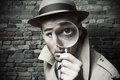 Vintage detective looking through a magnifier funny Royalty Free Stock Photo