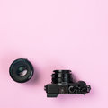 Vintage digital compact camera and fix lens 50mm on pink pastel Royalty Free Stock Photo