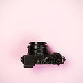 Vintage digital compact camera on pink pastel color background Royalty Free Stock Photo