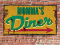 Vintage diner tin sign on brick wall Stock Images