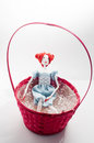 Vintage doll in a basket Royalty Free Stock Photo